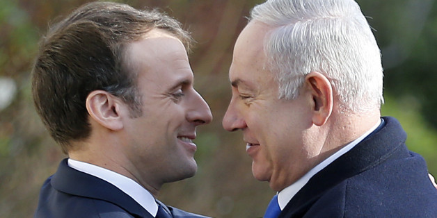 PARIS, FRANCE - DECEMBER 10:  French President, Emmanuel Macron (L) welcomes Israeli Prime Minister Benjamin Netanyahu prior to their meeting at the Elysee Presidential Palace on December 10, 2017 in Paris, France. Netanyahu is on an official visit to Paris. A few days ago US President Donald Trump recognized Jerusalem as the capital of Israel and ordered that the US embassy be moved there from Tel Aviv.  (Photo by Chesnot/Getty Images)
