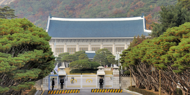 Seoul, South Korea- November 11, 2015: Security officials on duty at the front gate of South Korea presidential office. It is also known as The Blue House due to its blue color roof tiles. November 11, 2015 Seoul, South Korea.