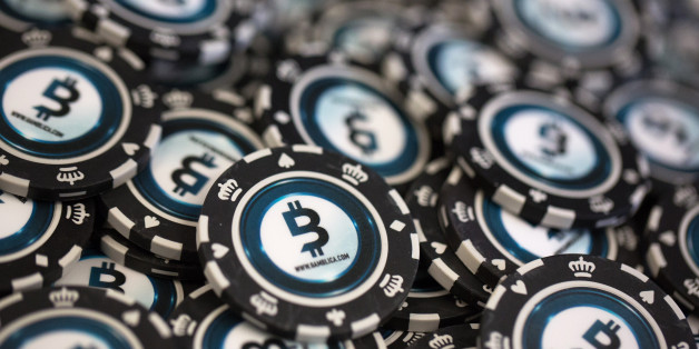 Casino gambling chips decorated with bitcoin logos sit on display at the CrytoSpace conference in Moscow, Russia, on Friday, Dec. 8, 2017. CryptoSpace is Eastern Europe's largest conference dedicated to blockchain technology and cryptocurrencies and runs Dec. 8-9. Photographer: Andrey Rudakov/Bloomberg via Getty Images