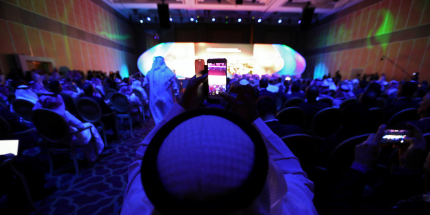 A saudi national films the inauguration with his smart phone at Saudi-US CEO Forum 2017 ahead of the arrival of the U.S. President Donald Trump, in Riyadh, Saudi Arabia May 20, 2017. REUTERS/Hamad I Mohammed
