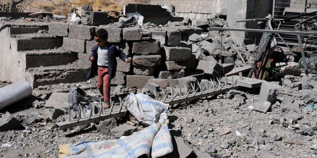 SANA'A, YEMEN – DECEMBER 09: A boy walks on rubble of Yemen's State Satellite Television Station after it was targeted by airstrikes of the Saudi-led coalition on December 09, 2017 in Sana'a, Yemen. At least four journalists were killed by airstrikes hit the Yemen's State Satellite Television Station. (Photo by Mohammed Hamoud/Getty Images)