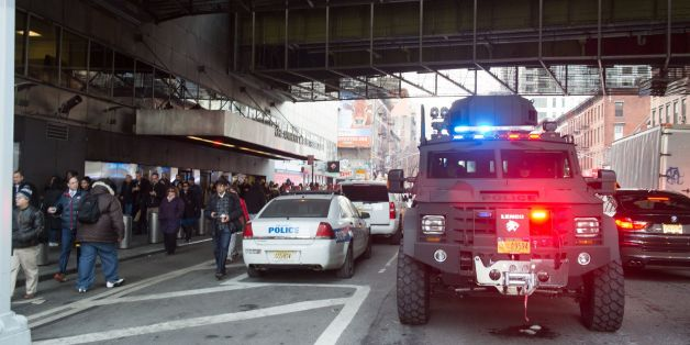 Police and other first responders respond to a reported explosion at the Port Authority Bus Terminal on December 11, 2017 in New York.New York police said Monday that they were investigating an explosion of 'unknown origin' in busy downtown Manhattan, and that people were being evacuated. Media reports said at least one person had been detained after the blast near the Port Authority transit terminal, close to Times Square.Early media reports said the blast came from a pipe bomb, and that severa