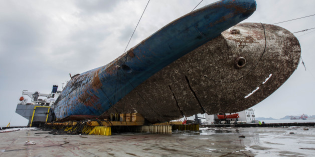 The sunken ferry Sewol on a semi-submersible transport vessel is seen during the salvage operation in waters off Jindo, South Korea. Salvage crews towed the corroded 6,800-ton South Korean ferry and loaded it onto a semi-submersible transport vessel Saturday, completing what was seen as the most difficult part of the massive effort to bring the ship back to shore nearly three years after it sank.  / KOREAN MINISTRY OF OCEANS AND FISHERIES