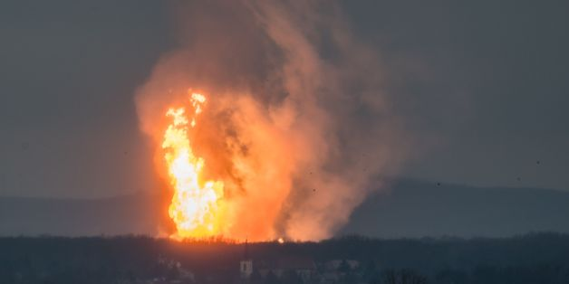 TOPSHOT - This picture taken on December 12, 2017 shows Austria's main gas pipeline hub at Baumgarten, Eastern Vienna, where an explosion rocked the site.The Kronen-Zeitung daily reported on its website that 60 people were hurt and that several fire brigades from the surrounding area were called. / AFP PHOTO / Tomas HULIK        (Photo credit should read TOMAS HULIK/AFP/Getty Images)