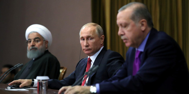 Iran's President Hassan Rouhani together with his counterparts Russia's Vladimir Putin and Turkey's Tayyip Erdogan attend a joint news conference following their meeting in Sochi, Russia November 22, 2017. Sputnik/Mikhail Klimentyev/Kremlin via REUTERS ATTENTION EDITORS - THIS IMAGE WAS PROVIDED BY A THIRD PARTY.
