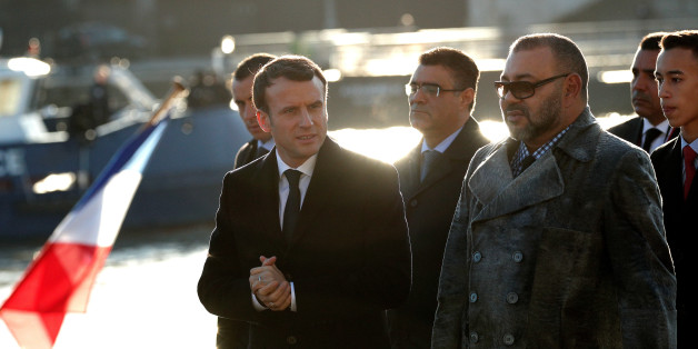 French President Emmanuel Macron (L) and Morocco's King Mohammed VI (R) board the 'Mirage' boat on the Seine river with other heads of State and government prior going to the Ile Seguin near Paris as part of the One Planet Summit, France, December 12, 2017. REUTERS/Yoan Valat/Pool
