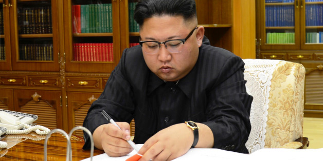 North Korean Leader Kim Jong Un signs the order to carry out the test-fire of inter-continental ballistic rocket Hwasong-14 in this undated photo released by North Korea's Korean Central News Agency (KCNA) in Pyongyang, July, 4 2017. KCNA/via REUTERS ATTENTION EDITORS - THIS IMAGE WAS PROVIDED BY A THIRD PARTY. REUTERS IS UNABLE TO INDEPENDENTLY VERIFY THIS IMAGE. NO THIRD PARTY SALES. SOUTH KOREA OUT.     TPX IMAGES OF THE DAY