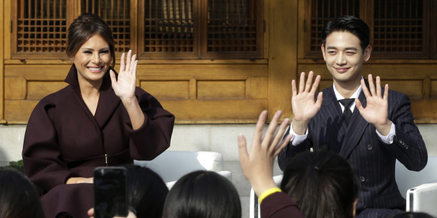 US First Lady Melania Trump (L) and Choi Min-ho, a member of South Korean boy band Shinee, wave to South Korean middle school students during the 'Girls Play 2!' Initiative, an Olympic public diplomacy outreach campaign, at the US Ambassador's Residence in Seoul on November 7, 2017.  / AFP PHOTO / POOL / Ahn Young-joon        (Photo credit should read AHN YOUNG-JOON/AFP/Getty Images)