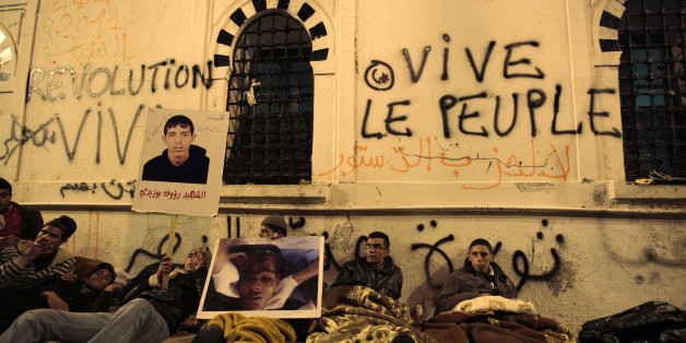 Protesters from Tunisia's marginalised rural heartlands prepare to spend their second night outside the Prime Minister's office in Tunis January 24, 2011. Protesters demonstrated in the capital on Sunday to demand that the revolution they started should now sweep the remnants of the fallen president's old guard from power. REUTERS/Zohra Bensemra (TUNISIA - Tags: POLITICS CIVIL UNREST SOCIETY)