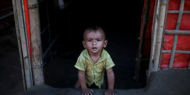 A Rohingya refugee baby sits at the entrance of his family's temporary shelter at the Onchiprang refugee camp near Cox's Bazar, Bangladesh December 13, 2017. REUTERS/Alkis Konstantinidis