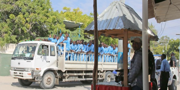MOGADISHU, SOMALIA - DECEMBER 14:  Somalian police cadets on a truck are seen at the scene after a suicide attack at police academy in Mogadishu, Somalia on December 14, 2017. At least 10 people were killed and 15 others injured after a suicide bomber wearing a police uniform blew up himself outside a police academy in the Somali capital, Mogadishu, local media reported. The suicide bomber infiltrated the police checkpoints and blew up himself during a police gathering, Somali National News Agen