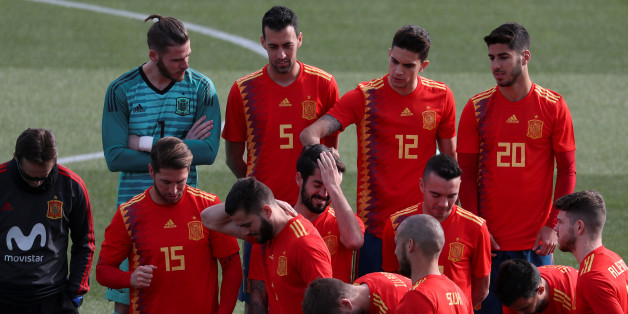Spain's national team player Marc Bartra touches teammate Isco's hair as they get ready to pose wearing the new Spanish kit for the upcoming 2018 World Cup at the training grounds in Las Rozas, outside Madrid, Spain, November 8, 2017. REUTERS/Susana Vera