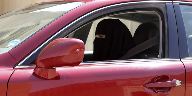 A woman drives a car in Saudi Arabia October 22, 2013. A conservative Saudi Arabian cleric has said women who drive risk damaging their ovaries and bearing children with clinical problems, countering activists who are trying to end the Islamic kingdom's male-only driving rules. Saudi Arabia is the only country in the world where women are barred from driving, but debate about the ban, once confined to the private sphere and social media, is increasingly spreading to public forums too. REUTERS/Fa