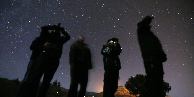 People use night vision goggles to look at the night sky during an Unidentified Flying Object (UFO) tour in the desert outside Sedona, Arizona February 14, 2013. Picture taken February 14, 2013.   REUTERS/Mike Blake   (UNITED STATES - Tags: SOCIETY SCIENCE TECHNOLOGY TPX IMAGES OF THE DAY)