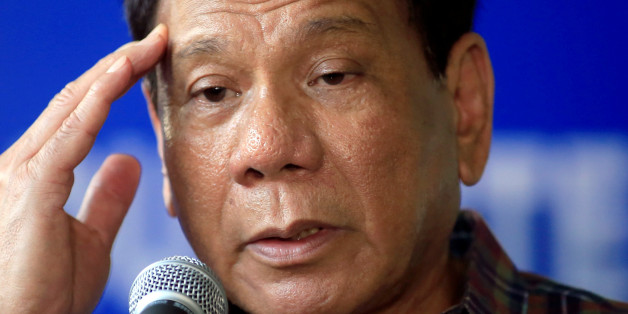 Philippines' President Rodrigo Duterte answer questions during a press briefing after awarding wounded soldiers, who fight against the insurgents of the Maute group, which has taken over large parts of the Marawi city, during his visit at the military camp hospital in Cagayan De Oro, Philippines June 11, 2017. REUTERS/Romeo Ranoco