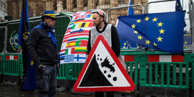 LONDON, ENGLAND - DECEMBER 13: Anti-brexit demonstrators gather with European Union flags outside the Houses of Parliament on December 13, 2017 in London, England. MPs are debating and voting on the EU withdrawal bill in Parliament today ahead of a crucial European Union council meeting tomorrow. (Photo by Jack Taylor/Getty Images)