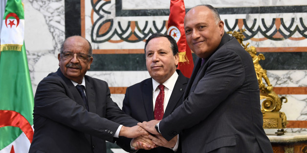 Tunisian Foreign Minister Khemaies Jhinaoui (C) holds hands with his Algerian counterpart Abdelkader Messahel (L) and Egyptian counterpart Sameh Shoukry (R) as they pose for a picture before a meeting to discuss efforts to resolve the Libyan conflict in the capital Tunis on December 17, 2017. / AFP PHOTO / FETHI BELAID        (Photo credit should read FETHI BELAID/AFP/Getty Images)