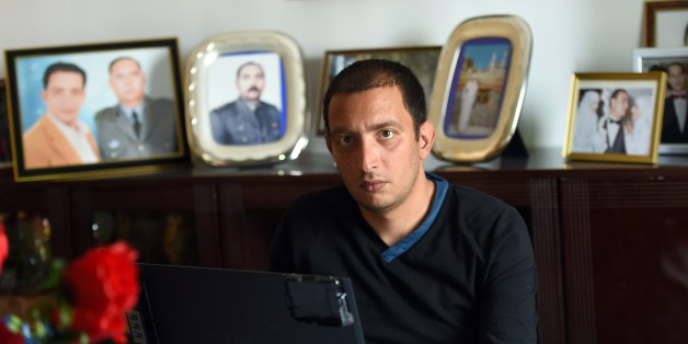 Tunisian blogger Yassine Ayari works on his laptop at home on April 17, 2015 in Tunis. Tunisian authorities have released a blogger handed six months in prison for defaming the army, after he served more than half his sentence, his brother said. AFP PHOTO / FETHI BELAID        (Photo credit should read FETHI BELAID/AFP/Getty Images)