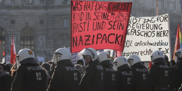 Austrian riot police guard protesters in front of the parliament during the swearing-in ceremony of the new government in Vienna, December 18, 2017 REUTERS/Heinz-Peter Bader