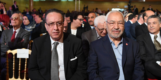 Hafedh Caid Essebsi (L), leader of Nidaa Tounes party, and Tunisian Islamist Ennahdha party leader Rached Ghannouchi, look on as they attend an official speech delivered by the Tunisian President Beji Caid Essebsi (unseen) on May 10, 2017 in Tunis.Essebsi said that the army will protect the output of Tunisia's main resources from being disrupted by protests over social and labour issues. / AFP PHOTO / FETHI BELAID        (Photo credit should read FETHI BELAID/AFP/Getty Images)