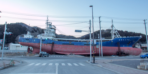 Kesenuma, Japan - February 03, 2013:  This picture was taken 1 year and 11 moths after 2011 Tohoku earthquake and tsunami disaster, giving an idea of the destruction that the tsunami left on the territory. 330-ton trawler Kyotomaru was swept around 500 meters inland by the tsunami on March 11, 2011. It also survived a subsequent fire that engulfed the small city on Japan's northeast coast. The ship was dismantled 7 month after this shot around 2013 September.