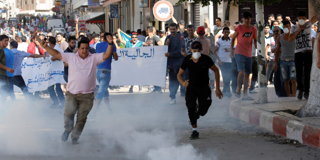 Riot police fired tear gas towards protesters during a demonstration against alleged corruption in the town of Al-Hoceima, Morocco July 20, 2017. REUTERS/Youssef Boudlal