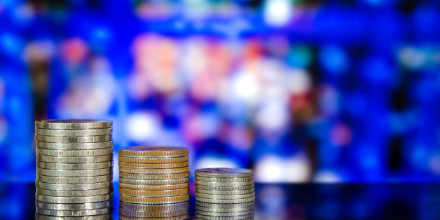 Finance and Money concept with savings, Money coin stack growing graph with bokeh of night cityscape light in background
