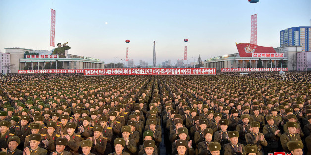 TOPSHOT - This December 1, 2017 picture released by North Korea's official Korean Central News Agency (KCNA) on December 2, 2017 shows North Korean soldiers and Pyongyang residents holding a rally to celebrate the North's declaration on November 29 it had achieved full nuclear statehood.North Korea's leader Kim Jong-Un declared the country had achieved a 'historic cause' of becoming a nuclear state, its state media said on November 29, after the country tested an intercontinental ballistic missi