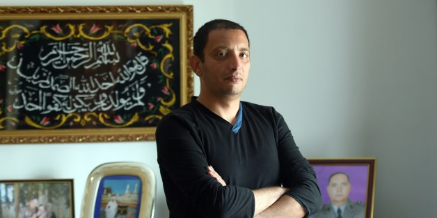 Tunisian blogger Yassine Ayari poses for a picture at home on April 17, 2015 in Tunis. Tunisian authorities have released a blogger handed six months in prison for defaming the army, after he served more than half his sentence, his brother said. AFP PHOTO / FETHI BELAID        (Photo credit should read FETHI BELAID/AFP/Getty Images)