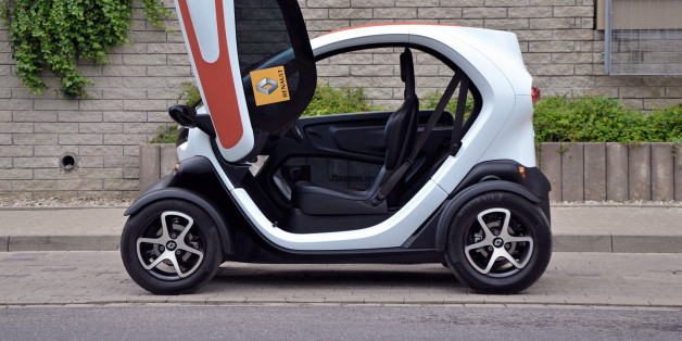 Warsaw, Poland - 6th, June, 2014: Electric micro-car Renault Twizy ZE with opening door parked on the street. Short and tight small cars are a solution to the narrow streets in many European cities.