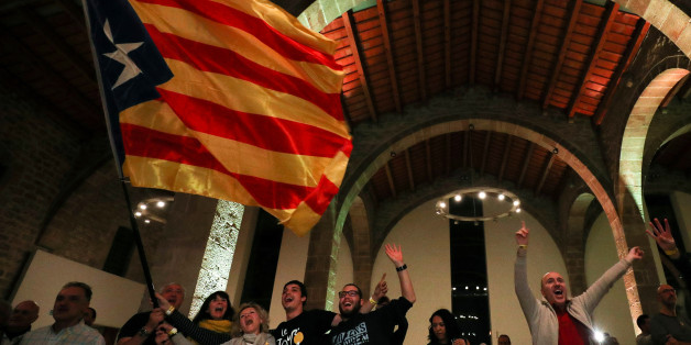 People react to results in Catalonia's regional elections at a gathering of the Catalan National Assembly (ANC) in Barcelona, Spain December 21, 2017. REUTERS/Albert Gea