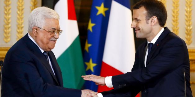 French President Emmanuel Macron (R) shakes hands with Palestinian President Mahmud Abbas at the end of a joint press conference following their meeting at the Elysee presidential Palace, in Paris, on December 22, 2017.Abbas visits France in the hopes that France takes a leading role in opposing the US recognition of Jerusalem as Israels capital. / AFP PHOTO / POOL / Francois Mori        (Photo credit should read FRANCOIS MORI/AFP/Getty Images)