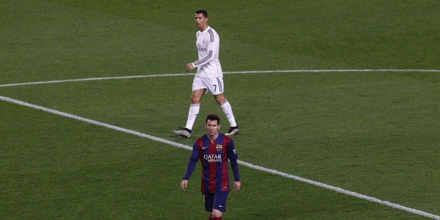 Barcelona's Argentinian forward Lionel Messi (DOWN)  and Real Madrid's Portuguese forward Cristiano Ronaldo walk on the field during the 'clasico' Spanish league football match FC Barcelona vs Real Madrid CF at the Camp Nou stadium in Barcelona on March 22, 2015. AFP PHOTO / QUIQUE GARCIA        (Photo credit should read QUIQUE GARCIA/AFP/Getty Images)