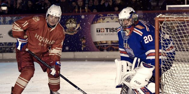 Russian President Vladimir Putin (L) takes part in the Night Hockey League match on the GUM department store skating rink at Red Square in Moscow on December 22, 2017. / AFP PHOTO / Sputnik / Alexey NIKOLSKY        (Photo credit should read ALEXEY NIKOLSKY/AFP/Getty Images)
