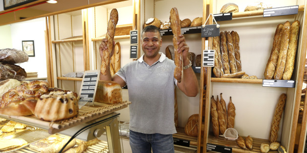 Parisian baker Ridha Khadher, winner of the Best Baguette of Paris 2013 award, holds his baguettes, French bread, as he poses in his bakery after the verdict in Paris April 25, 2013. The baguette is a French cultural symbol par excellence and the competition saw 203 Parisian bakers who compete for recognition as finest purveyor of one of France's most iconic staples. The baguettes are registered, given anonymous white wrappings and an identification number. They are then carefully weighed and me