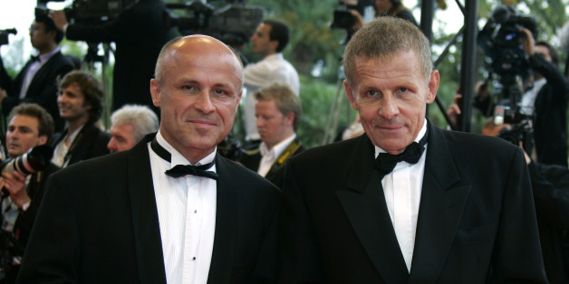 "Brothers Olivier (L) and Patrick Poivre d'Arvor arrive for a gala screening of U.S. director James Gray's film ""We Own The Night"" at the 60th Cannes Film Festival May 25, 2007.   REUTERS/Eric Gaillard  (FRANCE)"