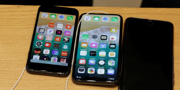 An Apple iPhone X model (C) is seen next to older models of iPhone on a table at an Apple store in New York, U.S., November 3, 2017.  REUTERS/Lucas Jackson