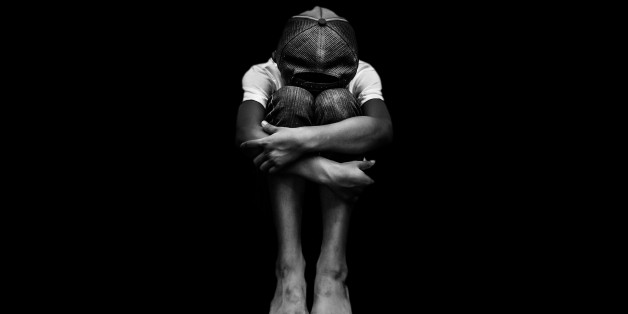 Young Asian boy, scared and alone. Hoping for a better future than the one that seems set. He is at high risk of being physically, mentally and emotionally abused and also trafficked.