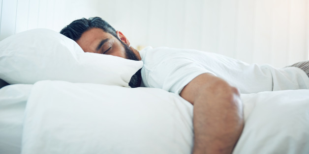 Shot of a mature man lying on his bed and sleeping