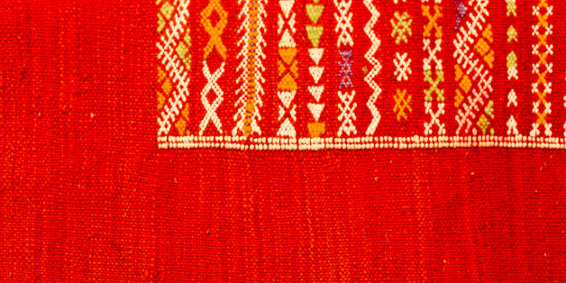 Handmade by berber woman colourful rugs in vibrant tones for sale in media souke