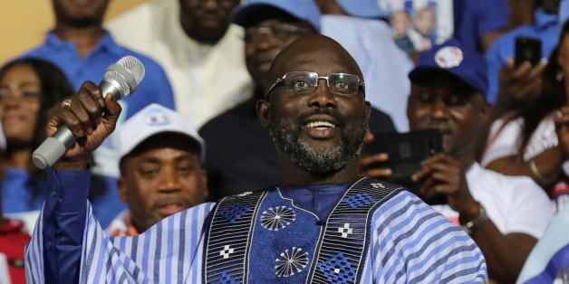 George Weah, former soccer player and presidential candidate of Congress for Democratic Change (CDC), reacts while a speech during the party's presidential campaign rally at Samuel Kanyon Doe Sports Complex in Monrovia, Liberia, December 23, 2017. REUTERS/Thierry Gouegnon