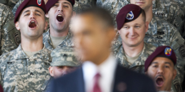 Troops yell in support at U.S. President Barack Obama as he speaks at Fort Bragg in Fayetteville, North Carolina December 14, 2011. REUTERS/Chris Keane (UNITED STATES - Tags: POLITICS MILITARY)