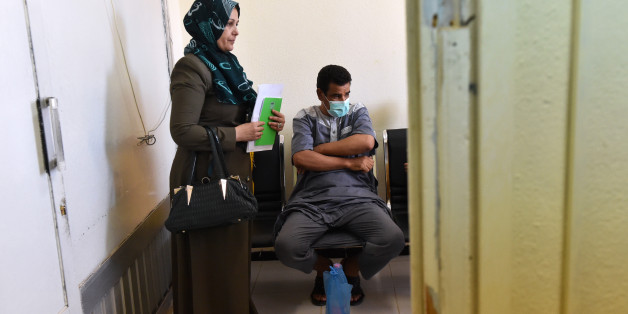 Algerian Abderahman, 47, who had a kidney transplant, stands next to his sister while waiting at Batna's university hospital's nephrology department, 435 kms east of Algiers, on July 26, 2017.In Algeria and across the entire Maghreb in North Africa, many people continue to suffer or die because of the lack of donors. Part of the problem lies with laws restricting the harvesting of human organs, coupled with cultural or religious reticence, despite Muslim theologians' approval of organ donations.