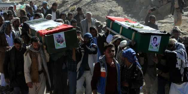 SANA'A, YEMEN – DECEMBER 26: People carry coffins of 11-members from one family after they were killed by airstrikes carried out by the Saudi-led coalition hit their house on Monday leaving the nine members including five children killed on December 26, 2017 in Sana'a, Yemen. The Houthi-run Saba news agency reported that at least 71 civilians, including 11 children, were killed in Yemen in 51 airstrikes carried out by the Saudi Arabia-led military coalition across the country over