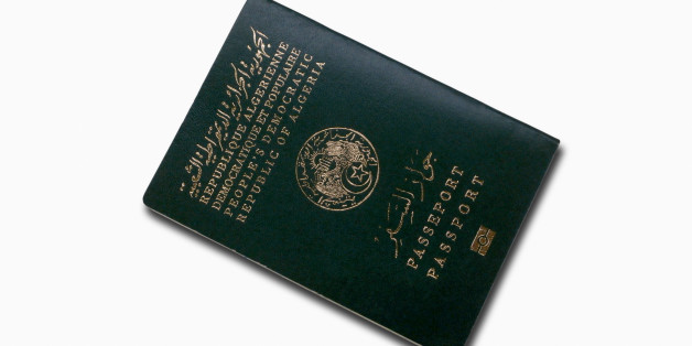 Close-up on an Algerian passport isolated on a white background.