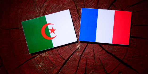 Algerian flag with French flag on a tree stump isolated