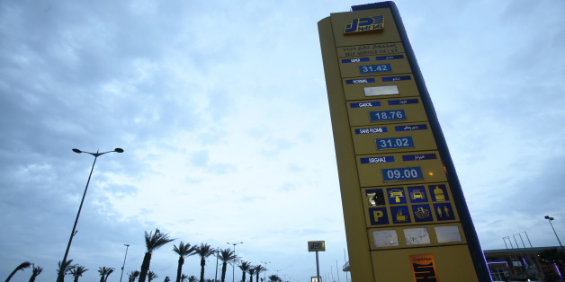 "A Naftal billboard shows prices at the entrance of the fuel station in the highway of Algiers, Algeria February 3, 2016. Unleaded fuel is priced at 31.02 dinar per litre. A dramatic drop in oil prices, driven down by a glut in supply, is translating into a mixed bag for motorists. All countries have access to the same oil prices on international markets, but retail prices vary wildly, largely because of taxes and subsidies. REUTERS/Ramzi Boudina SEARCH ""THE WIDER IMAGE"" FOR ALL STORIES"