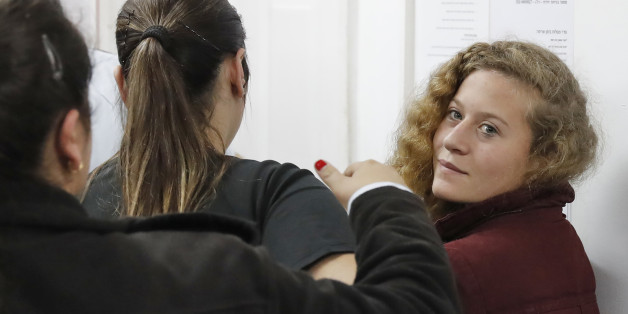 Palestinian Ahed Tamimi (R), 16, a well-known campaigner against Israel's occupation, appears at a military court at the Israeli-run Ofer prison in the West Bank village of Betunia on December 20, 2016. Israel's army arrested Tamimi on December 19, 2017, after a video went viral of her slapping Israeli soldiers in the occupied West Bank as they remained impassive. / AFP PHOTO / Ahmad GHARABLI        (Photo credit should read AHMAD GHARABLI/AFP/Getty Images)