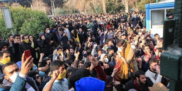 Iranian students protest at the University of Tehran during a demonstration driven by anger over economic problems, in the capital Tehran on December 30, 2017.Students protested in a third day of demonstrations, videos on social media showed, but were outnumbered by counter-demonstrators.  / AFP PHOTO / STR        (Photo credit should read STR/AFP/Getty Images)