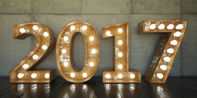 Lightbulb sign with 2017 against concrete wall